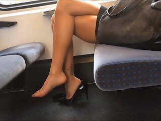 Lady with XXX wings adjacent to heels on the top of the train